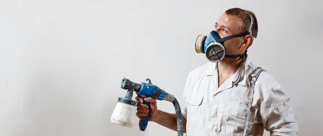 chicago-painting-wall-with-spray-gun